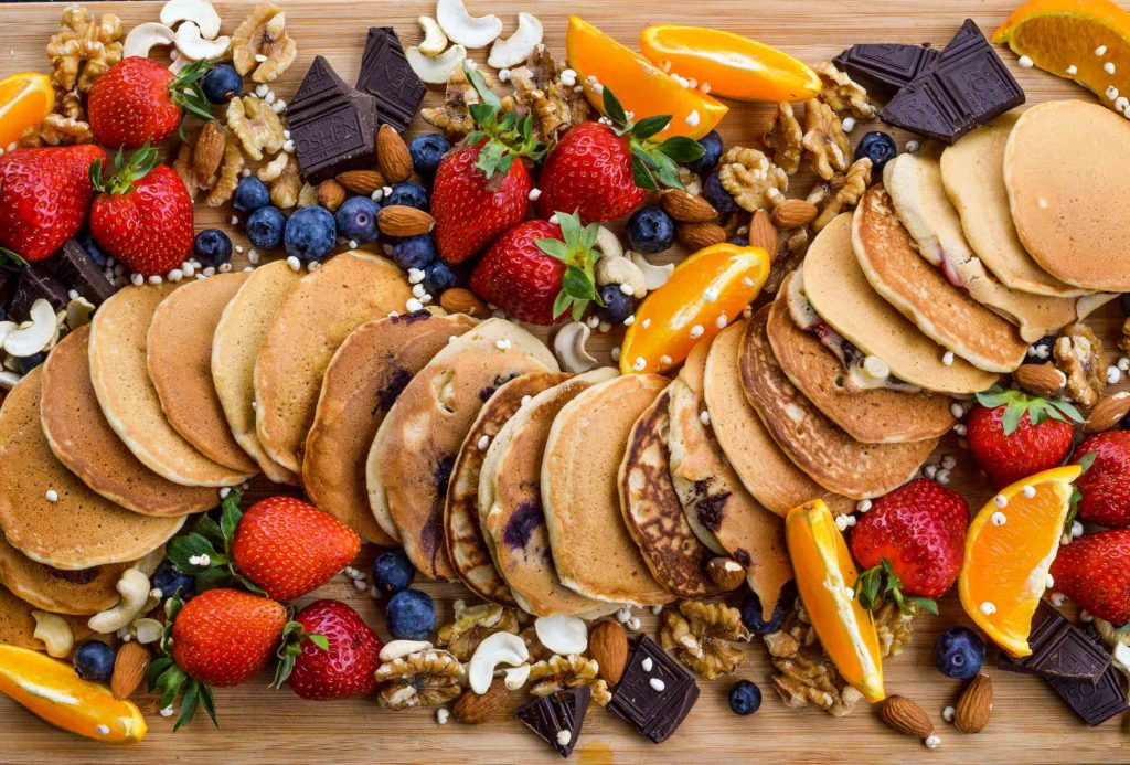 Pancakes board, nuts, berries, fruits, vegan pancakes, chocolate
