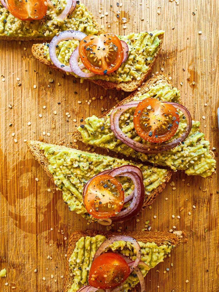 Avocado toast, cherry tomatoes, hemp seeds, whole meal bread, toast